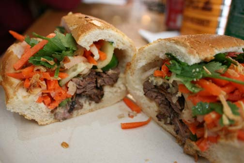 The Juicy Steak bahn mi has carrots, daikon, parsley and cucumbers and steak slices hidden behind the vegetation, so it does not fall out as easily when eaten. ALICE JONES | The Broadview