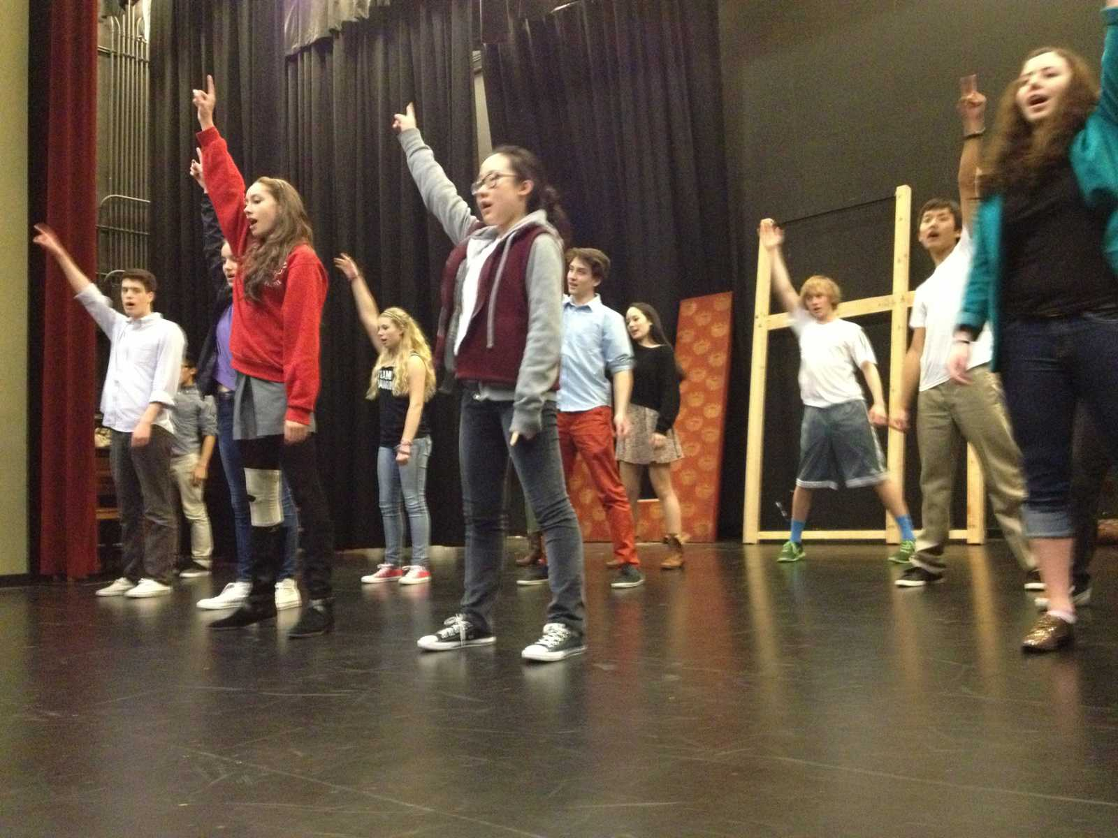 """Members of the cast of """"In the Heights"""" practice the choreography to the musical number """"Carnival."""" The play will premiere on March 13 and runs through the weekend."""