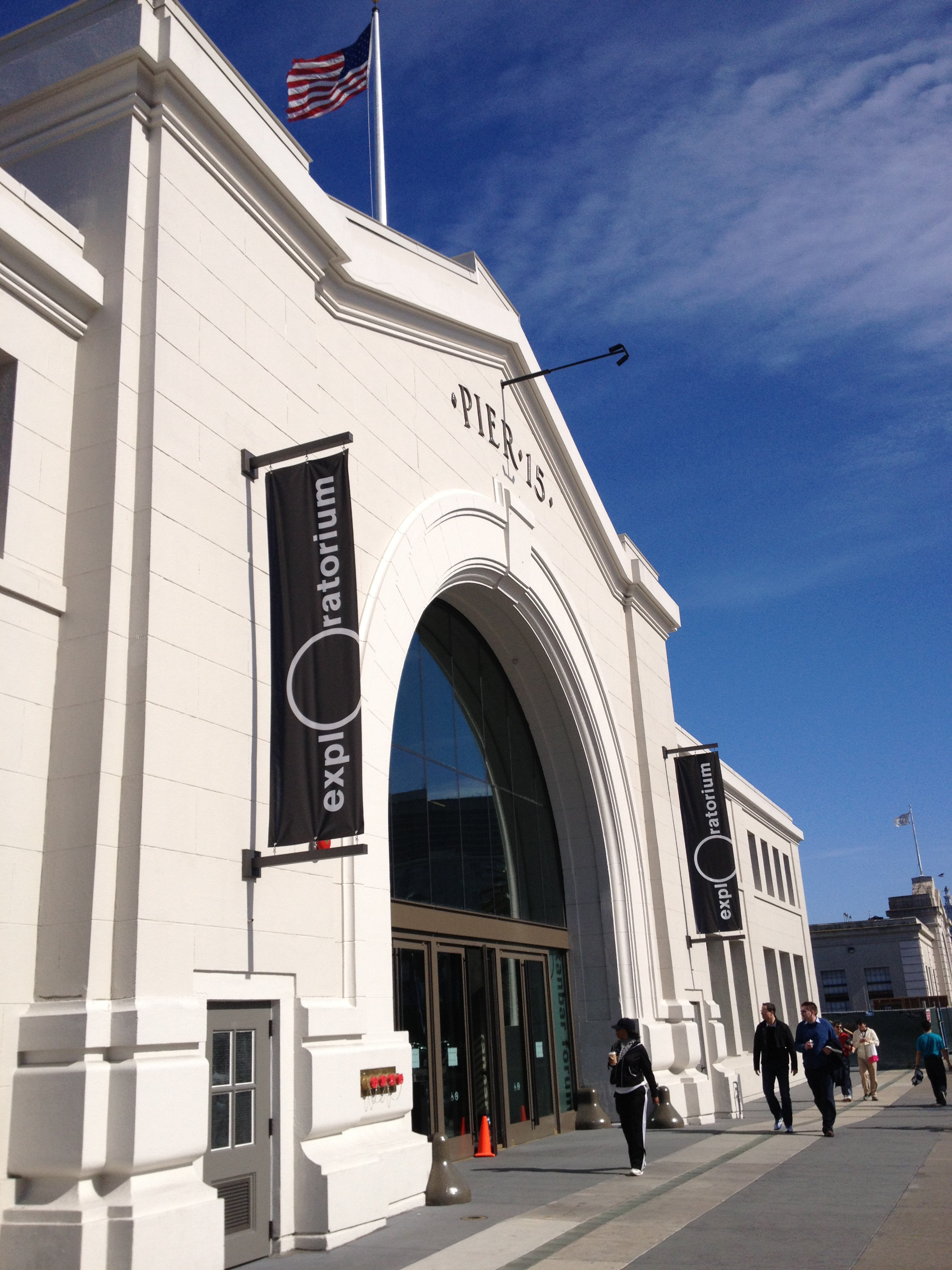 Passers-by look into the Exploratorium's new space at Pier 15 on the Embarcadero. Located on the water, the museum is set to open on April 17, proceeded by a gala the night before. The new space will feature 150 new exibits as well as outdoor exibits and a bay observatory.