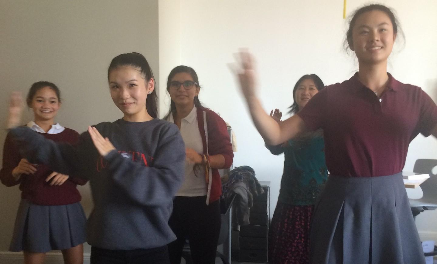 AP Mandarin students face the television as they engage in the interactive dance video.