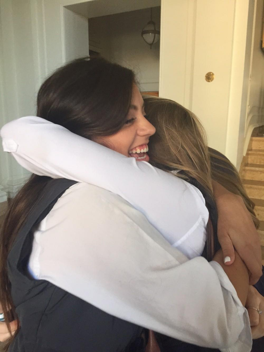 Sophomore Agustina Huneeus (left) hugs classmate Jocelyn Shilakes (right) goodbye last Friday in the Main Hall. Friday was Huneeus' last day at school before leaving for Barcelona.