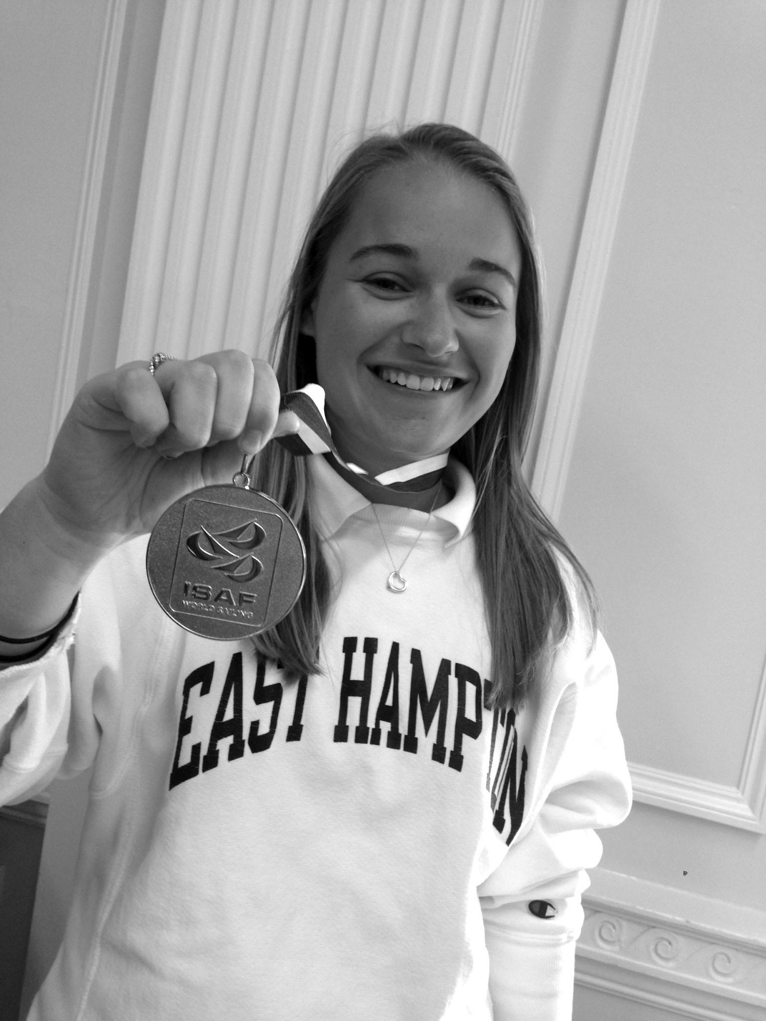 Senior Paige Dunlevy shows off her gold-medal from the International Sailing Federation Team-Racing World Championships. Dunlevy acted as replacement for a team member who was not eligible to compete.