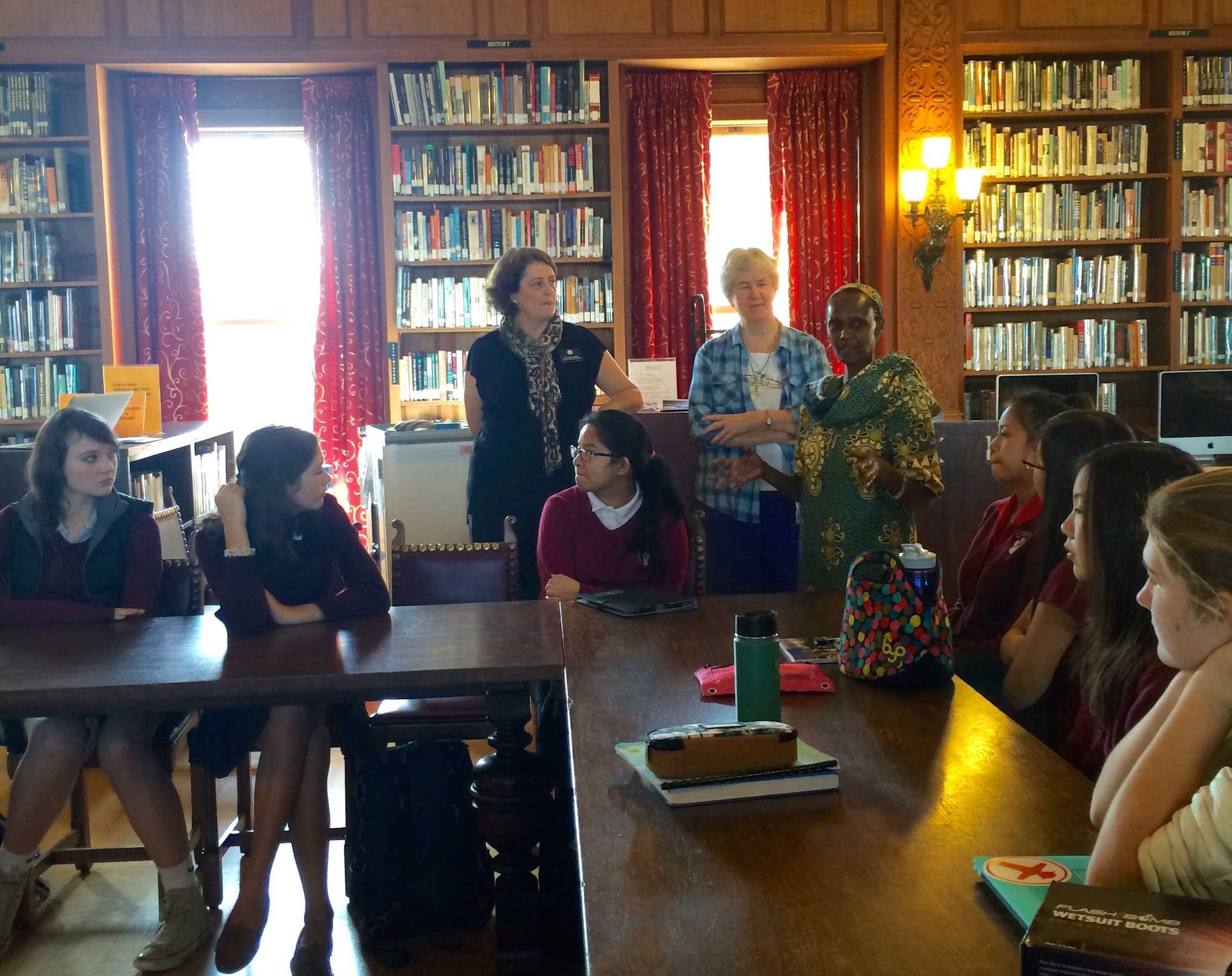 Tracy Sena, who visited Sacred Heart schools in Uganda with other Network teachers in 2012 (left to right), Sister Irene Cullen, RSCJ, and Sister Noellina Namusisi, RSCJ, speak to freshmen about girls education and contribution from Walk for Uganda.