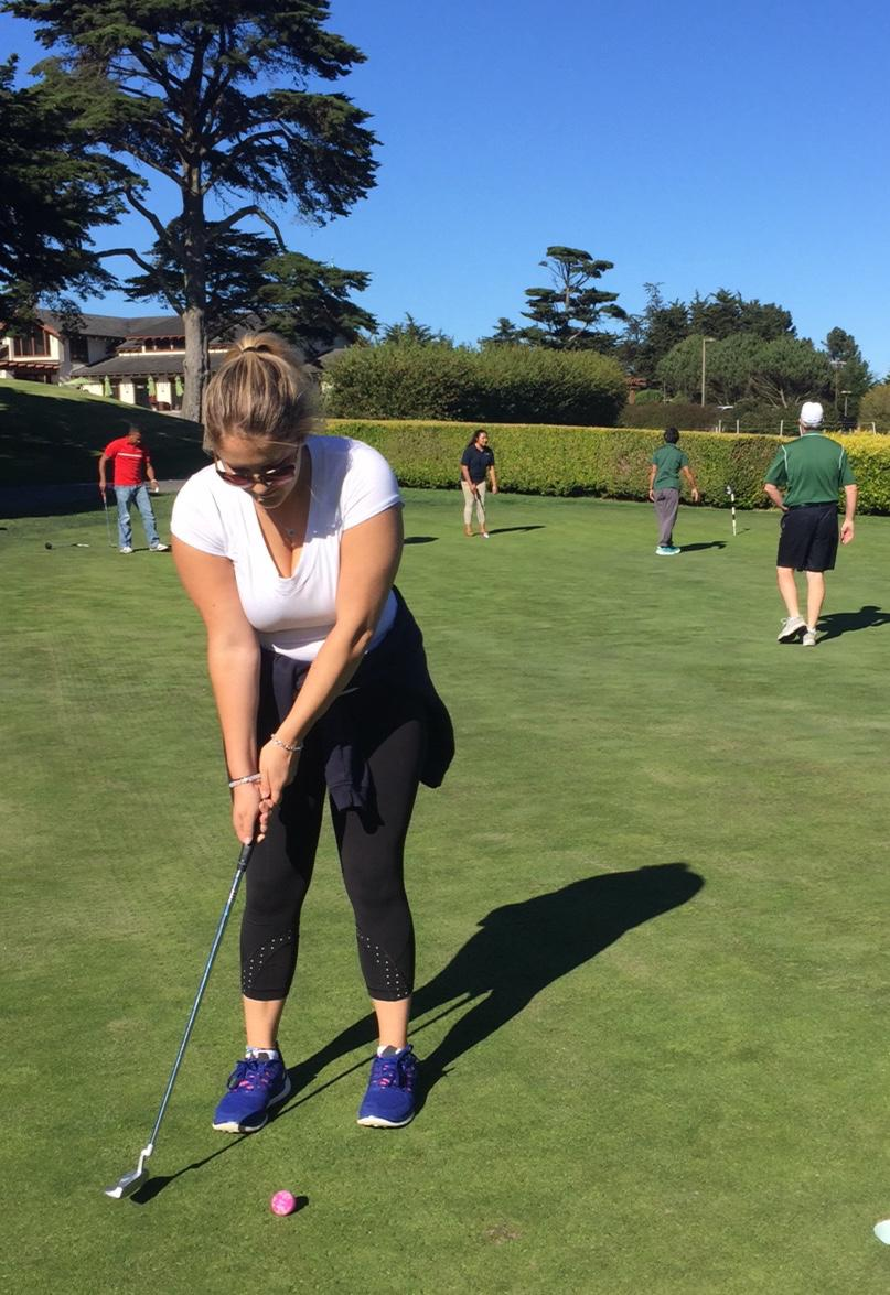 Senior Isabelle Coolins sports her protective eyewear while putting during practice at the Presidio Golf Course. Coolins purchased her glasses at LensCrafters.