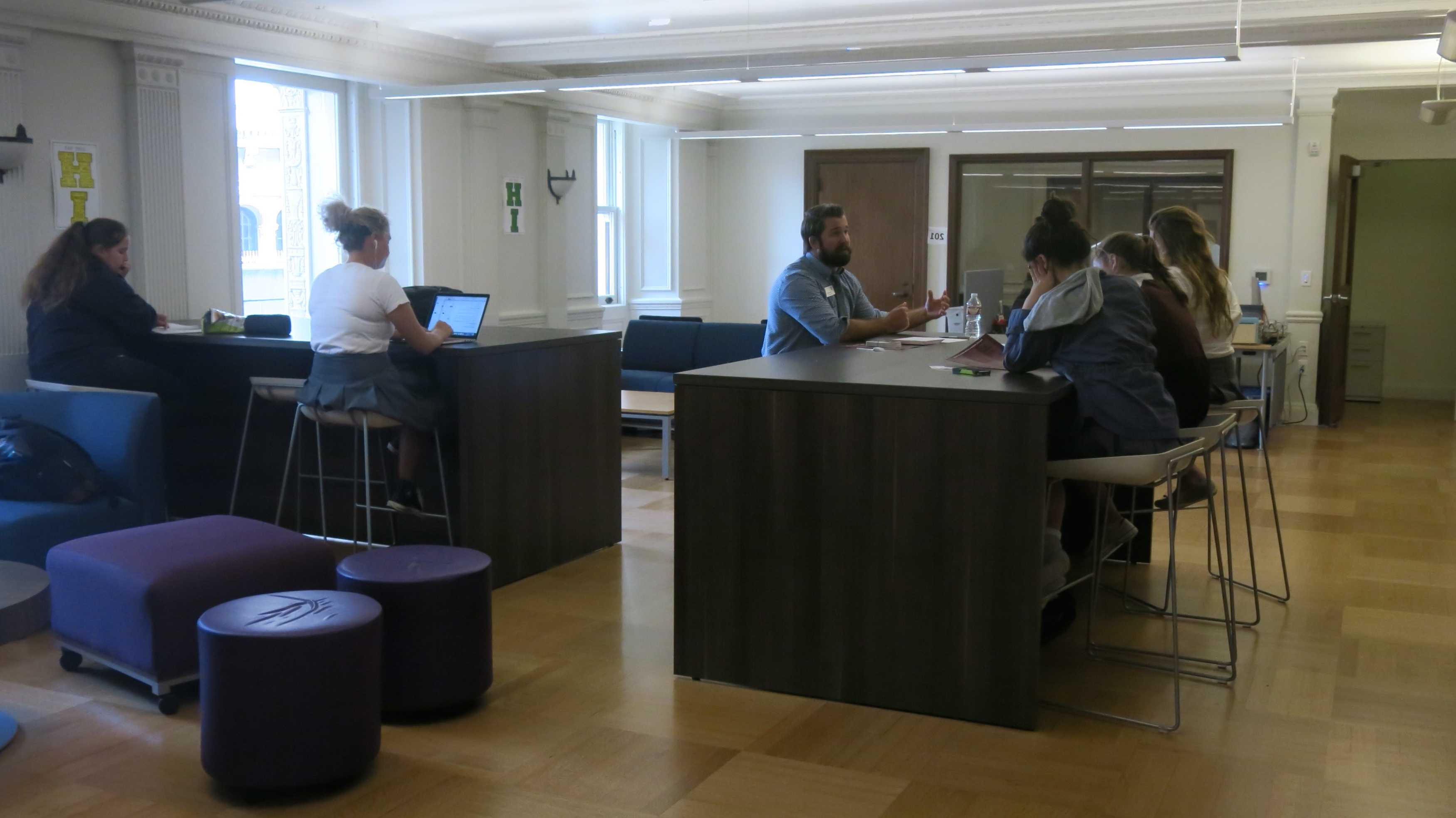 Juniors and seniors sit in the newly renovated Gallery on the second floor of the Flood Mansion. The floor houses a conference room and head of school Rachel Simpson's office.