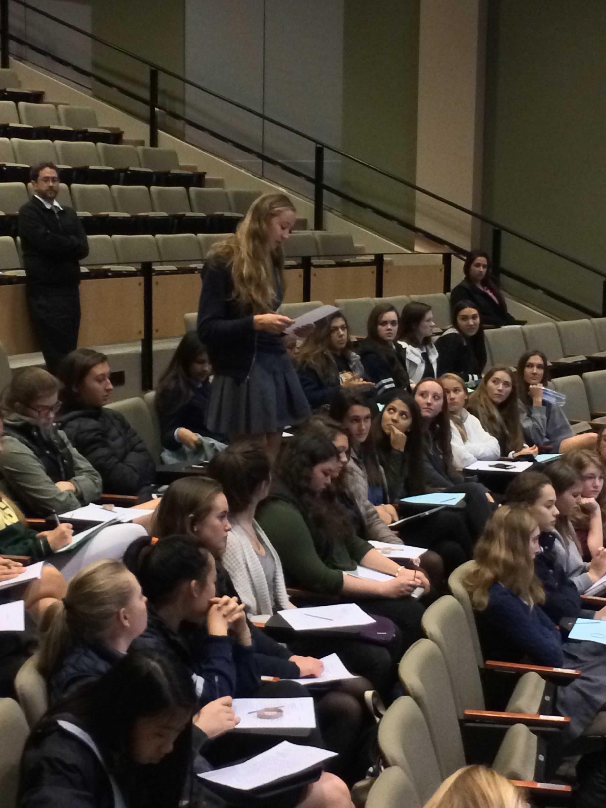 Audrey Brooke reads from her letter of apology, as members of her senior class and English teacher Mark Botti look on. The apology writing brought audience members into the case, and tried to give them a sense of the guilt felt by judges, juries, and everyone involved in legal cases when an innocent person is convicted.