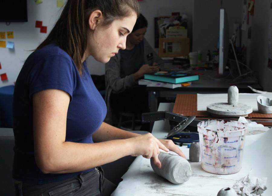 Stella+Smith-Werner+works+on+a+clay+piece+during+her+AP+Art+period.+Mrs.+McIntire%27s+AP+artists+work+in+a+variety+of+mediums+including+clay%2C+painting+and+photography.++++