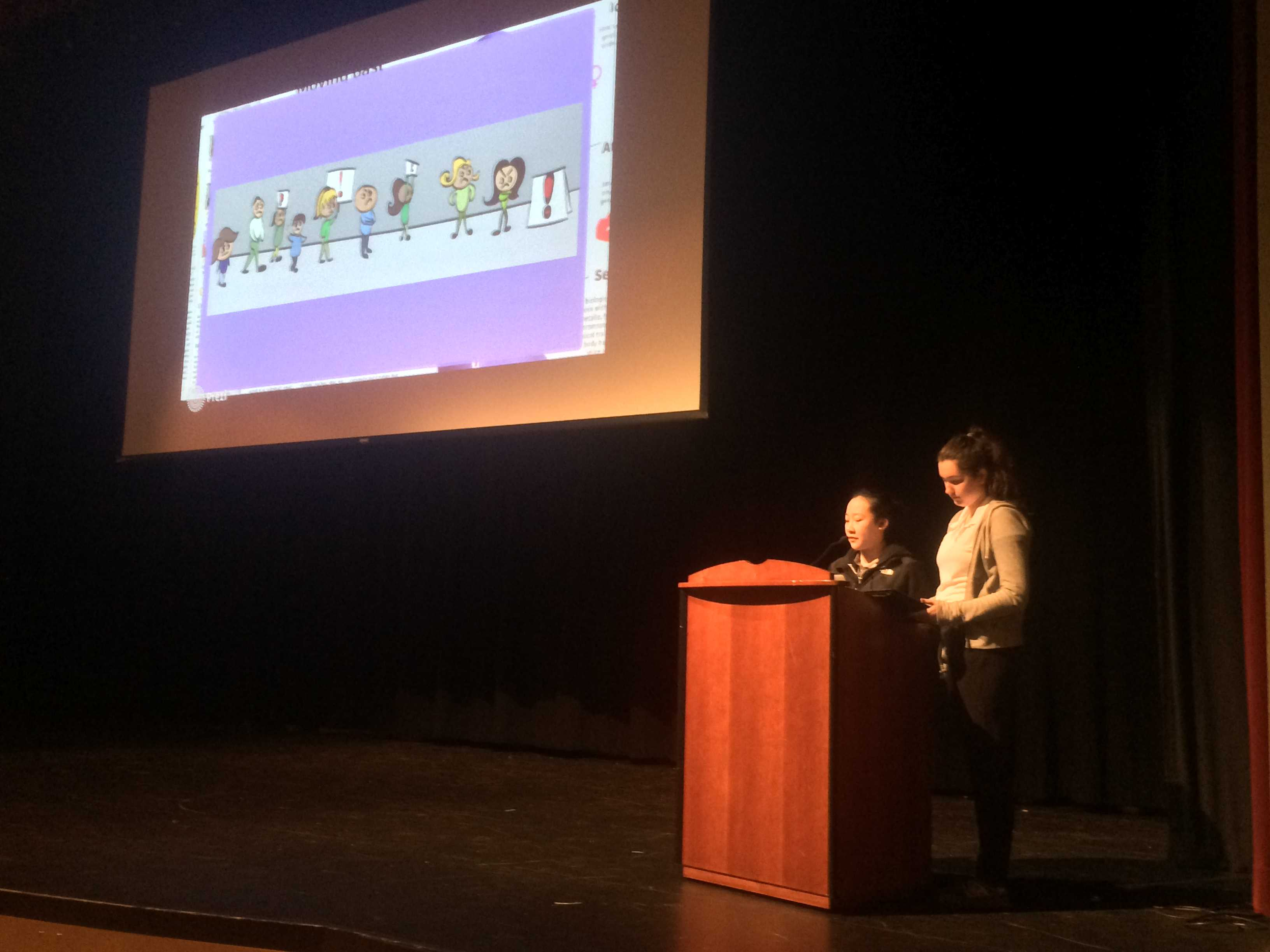 Editors Liana Lum and Kendra Harvey show a cartoon published in The Broadview as part of their press freedom and first amendment rights presentation today. Lum and Harvey asked students to name the first amendment rights and winners received (amend)mints.