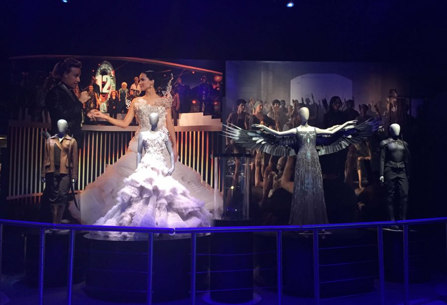 Katniss+Everdeen+is+highlighted+through+a+series+of+costumes+in+the+final+room+of+%22The+Hunger+Games%3A+The+Exhibition.%22+Six+exhibit+rooms+showcase+some+of+her+most+popular+outfits.