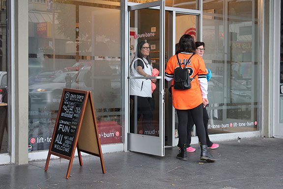 Clients leave Pure Barre on West Portal after their workout class. Barre classes have recently undergone a resurgence in popularity across the country.