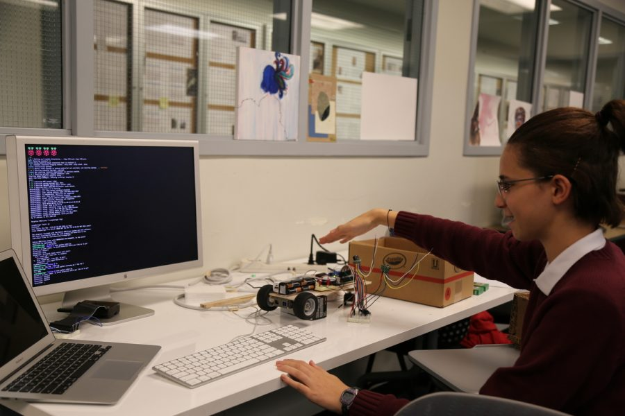 Lena+Jackson+programs+a+car+during+robotics.+Freshman+are+given+the+choice+to+take+either+a+semester+of+journalism+or+robotics.