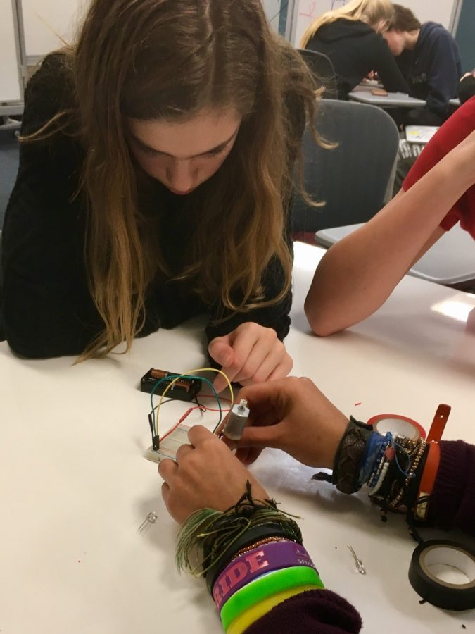 Robotics+team+member+Zoe+Hinks+works+on+an+in-class+activity+during+the+freshman+robotics+elective+class.+Hinks+will+participate+in+FIRST%E2%80%99s+Robotics+Competition+along+with+three+other+students.