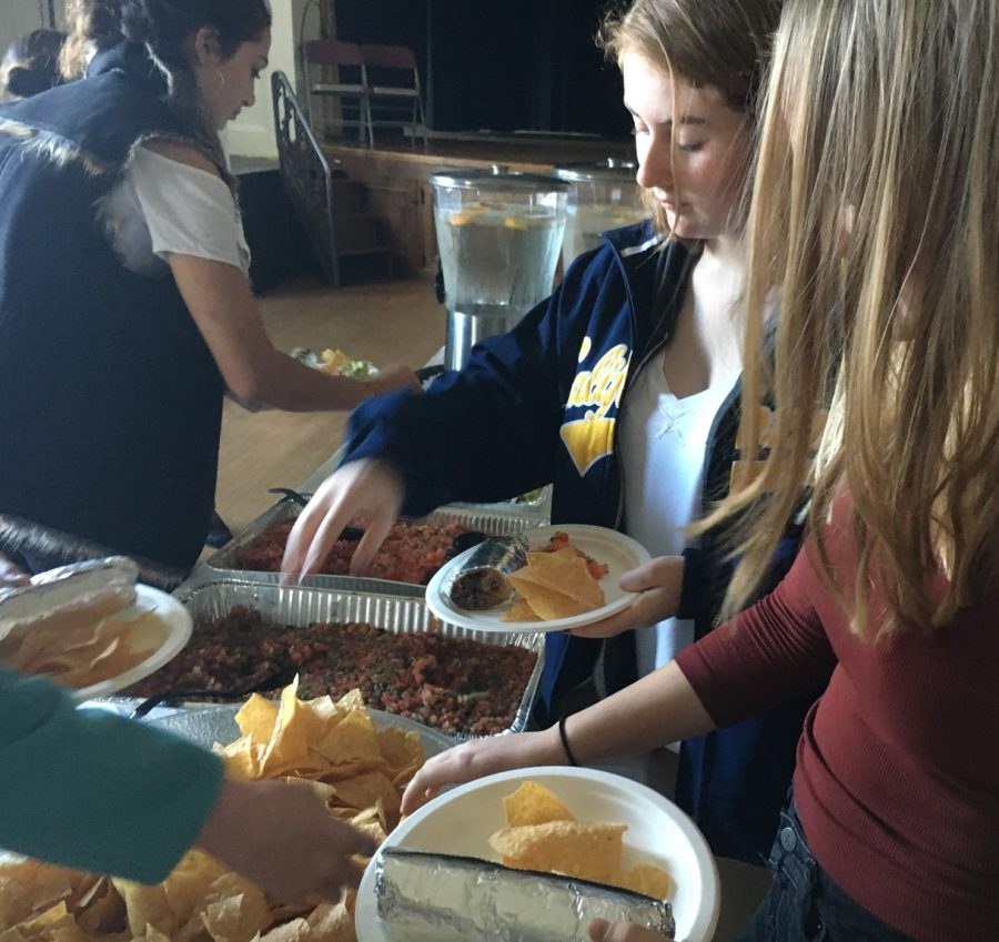Sophomores+Abby+Anderson%2C+Sophie+Egan+and+Sofia+Pirri+help+themselves+to+burritos%2C+chips+and+salsa+before+today%E2%80%99s+meeting.+The+meeting+went+through+lunch%2C+and+sophomores+were+invited+to+ask+any+questions+they+had+about+their+upcoming+trip.+