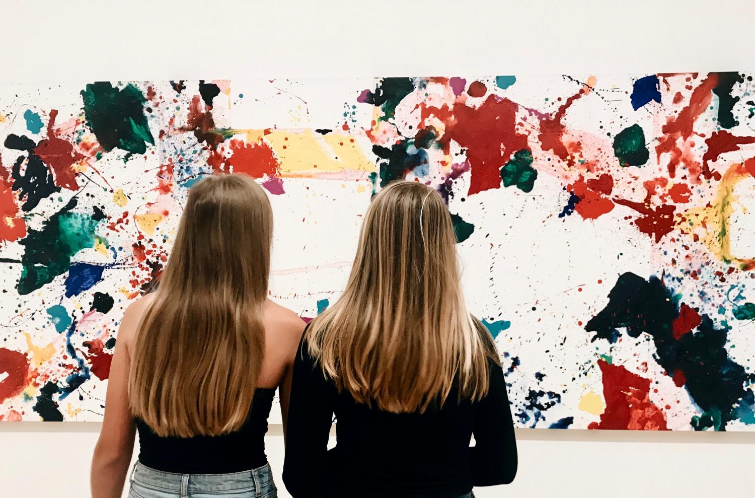 Juniors Abby Anderson and Maggie Walter analyze a work at the San Francisco Museum of Modern Art. The IB students were two of a large group who went to the museum to explore different art pieces and artists.