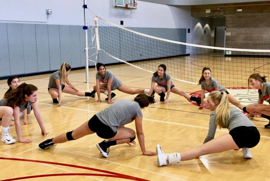 The+Varsity+Volleyball+team+stretches+together+to+prepare+for+practice+after+having+the+past+several+days+off.+The+team+as+well+as+all+other+school+related+sports%2C+resumed+practices++as+normal+today+after+school.+