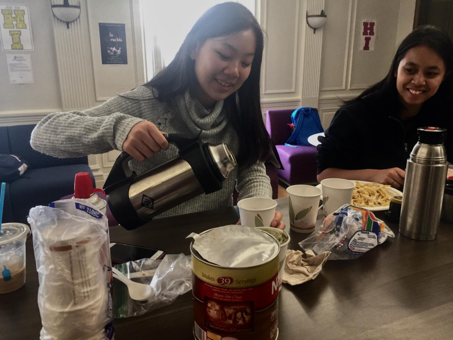 Kelly Chan pours hot chocolate as part of hot chocolate sale. The Service to the Homeless Club worked at the Haight Ashbury Food Program last week where they helped distribute food.