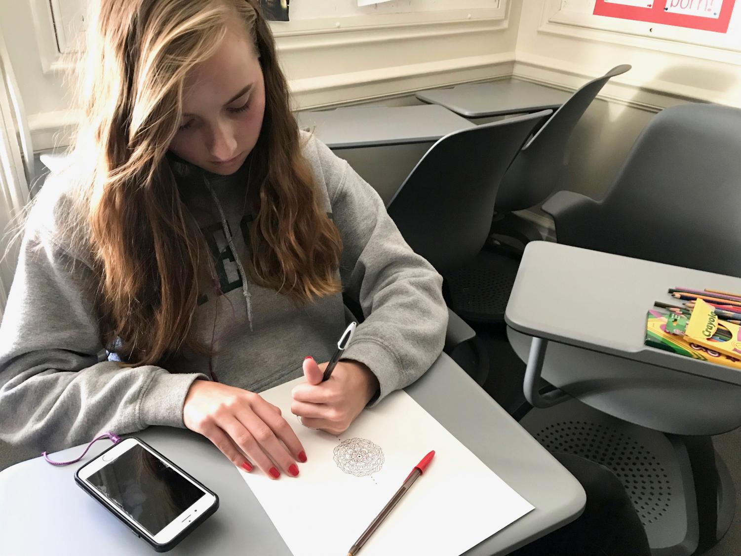 Sophomore Elsa Hagstrom draws a mandala during her World Religions class. Students learned about Buddhism and the use of art meditation prior to the mandala drawing class.