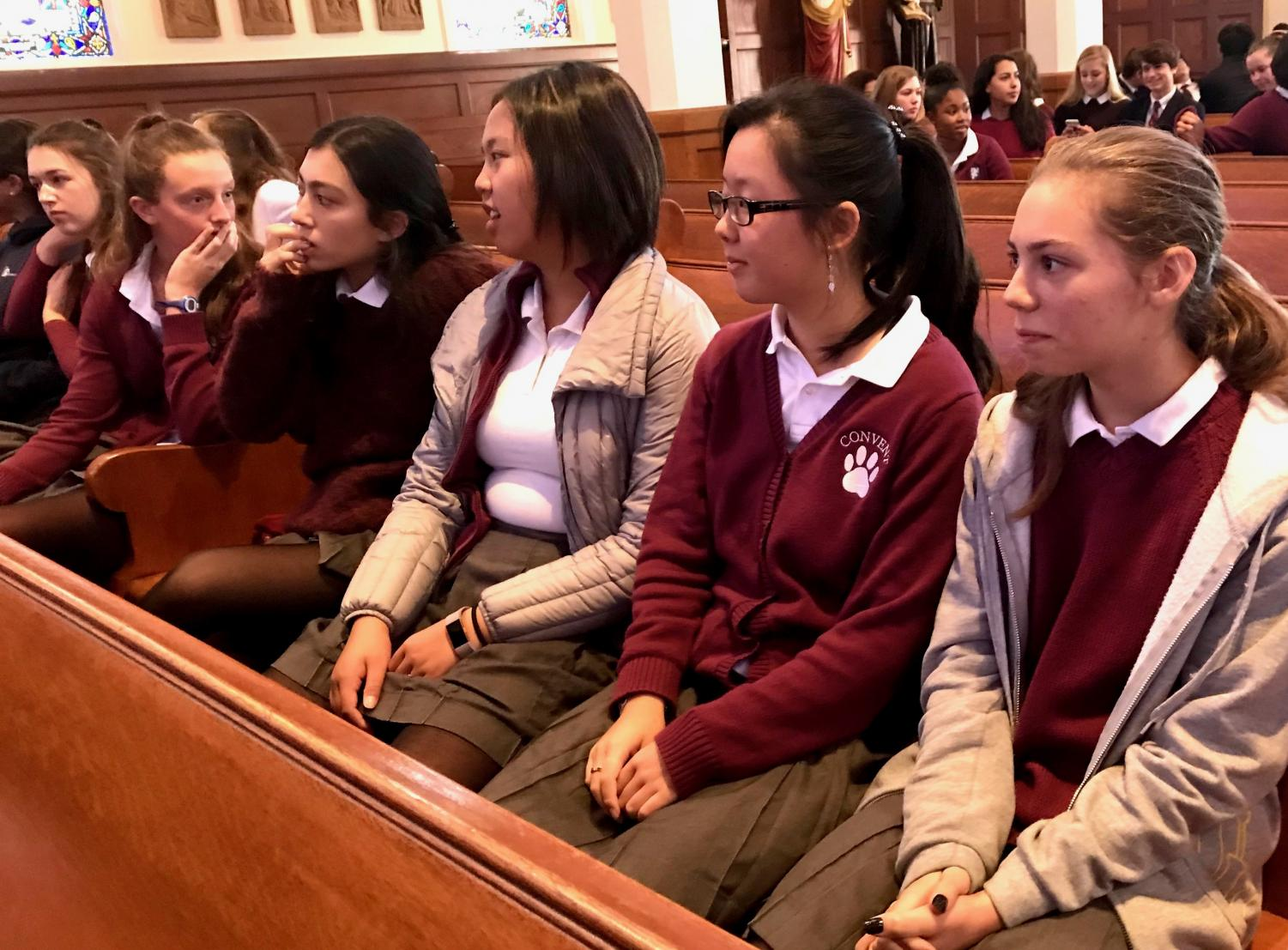Sophomores Zoe Hinks, Michelle Wang and Abby Widjanarko wait for Mass to begin. The Mass was coed, so students from the Broadway Campus had to wait for students coming from the Pine-Octavia campus arrive.