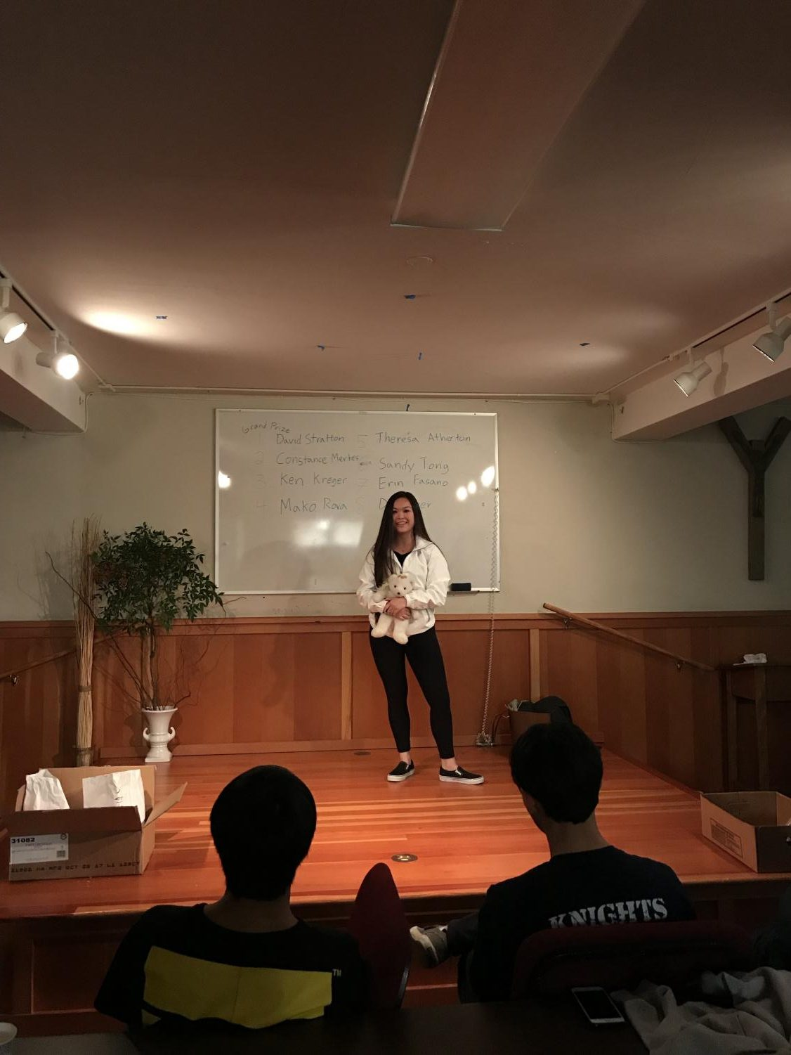 Senior Alayna Wong presents her favorite child hood item in front of the class. The entire class saw a movie called Wonder before they started sharing  childhood item.