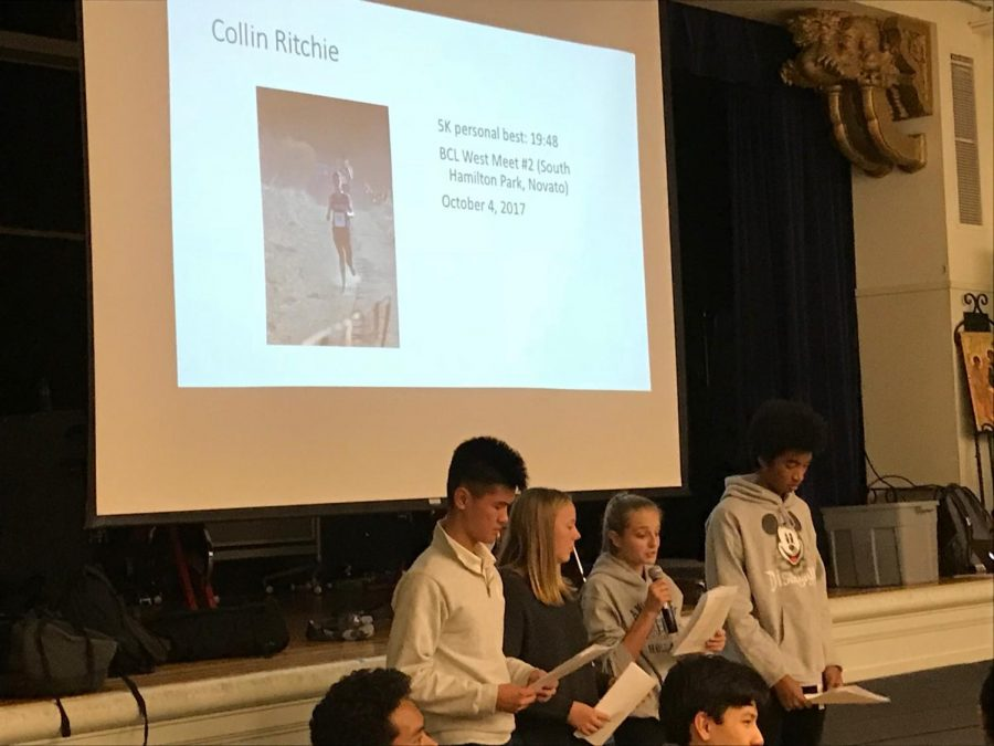 Cross-country+captain+Maggie+Walter+reads+a+tribute+to+team+member+Colin+Ritchie.+Each+runner+was+asked+to+write+a+short+paragraph+about+one+of+their+teammates%2C+which+the+team+captains+read+aloud+at+the+banquet.