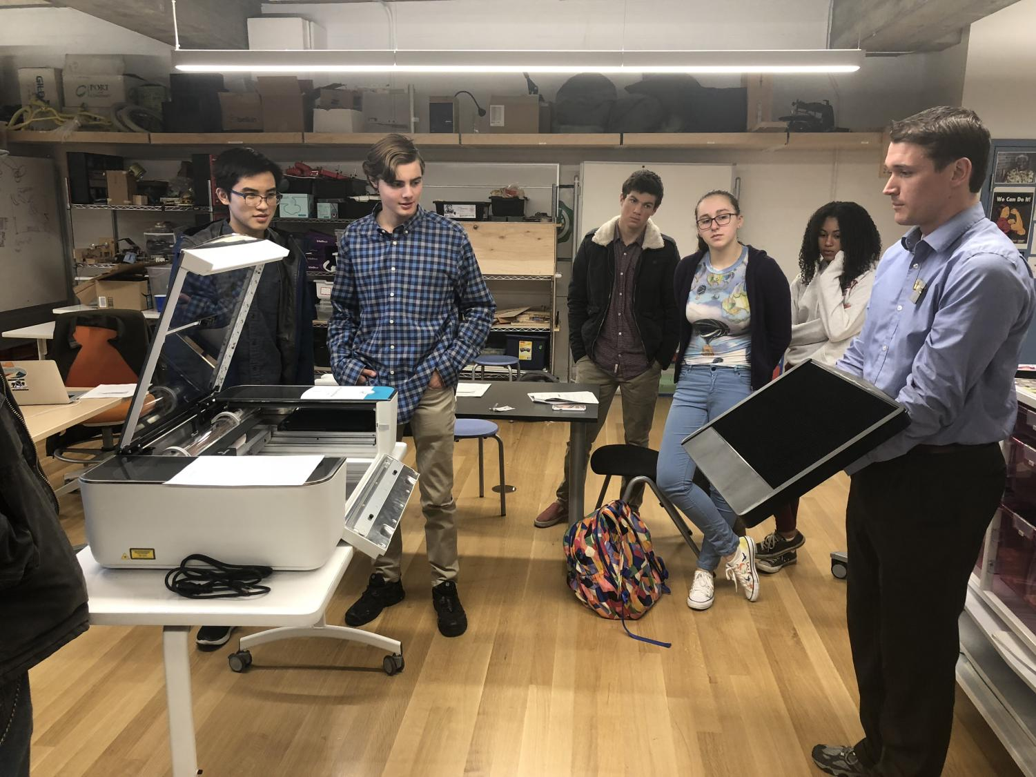 Students gather in Spark Studio for unveil of 3D laser printer. The printer was ordered two years ago and arrived in January.