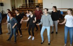 Performers continue musical rehearsals