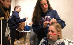 Community sets off in spirit for state game