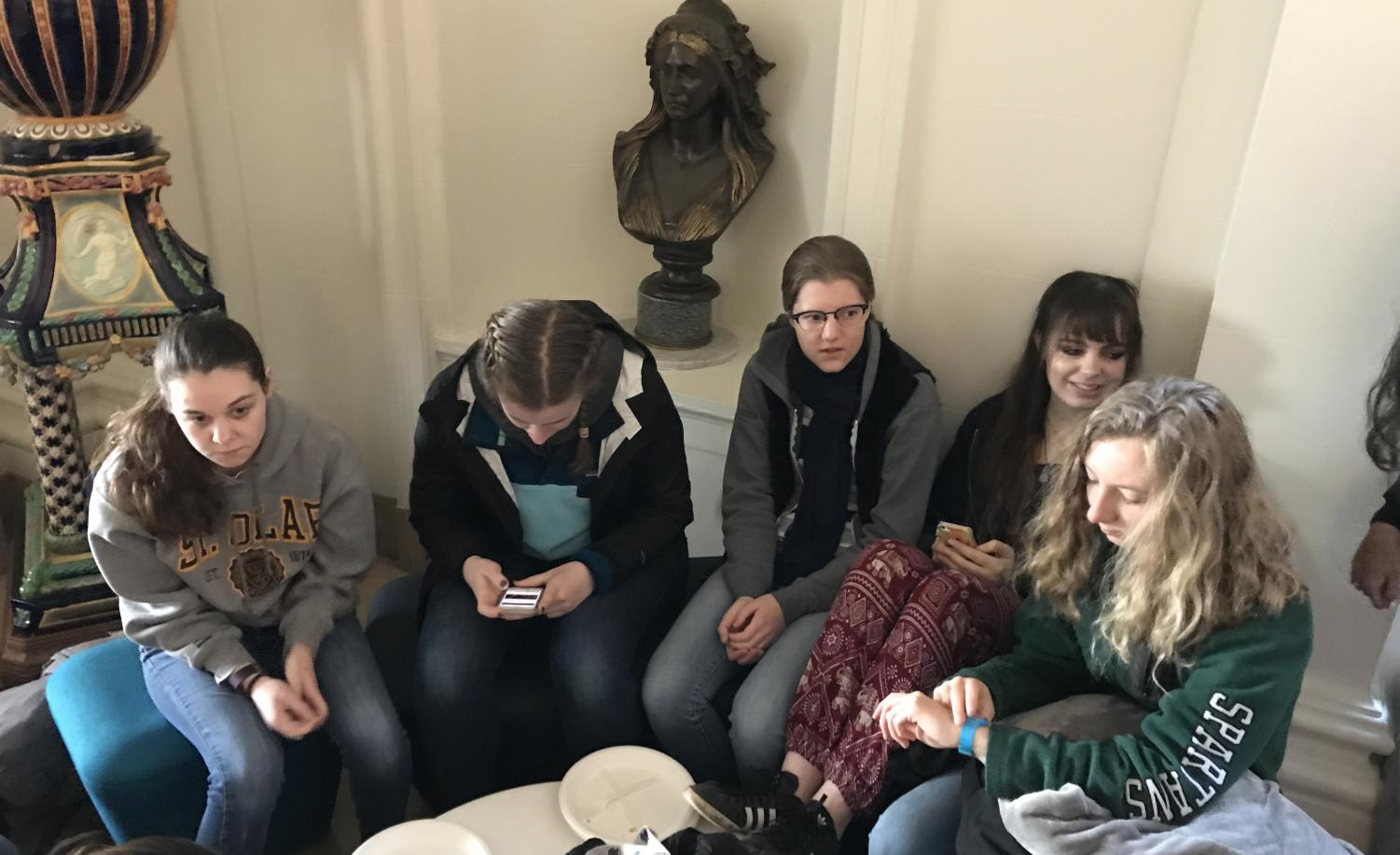 Seniors Mary Crawford, Claire Kosewic, Lizzie Bruce, Sarah Mahnke-Baum and Sydney O'Neil sit together in the Main Hall before departing for Marin. The group left Convent around 8 a.m. Friday morning and plans to return Saturday afternoon at 2 p.m.