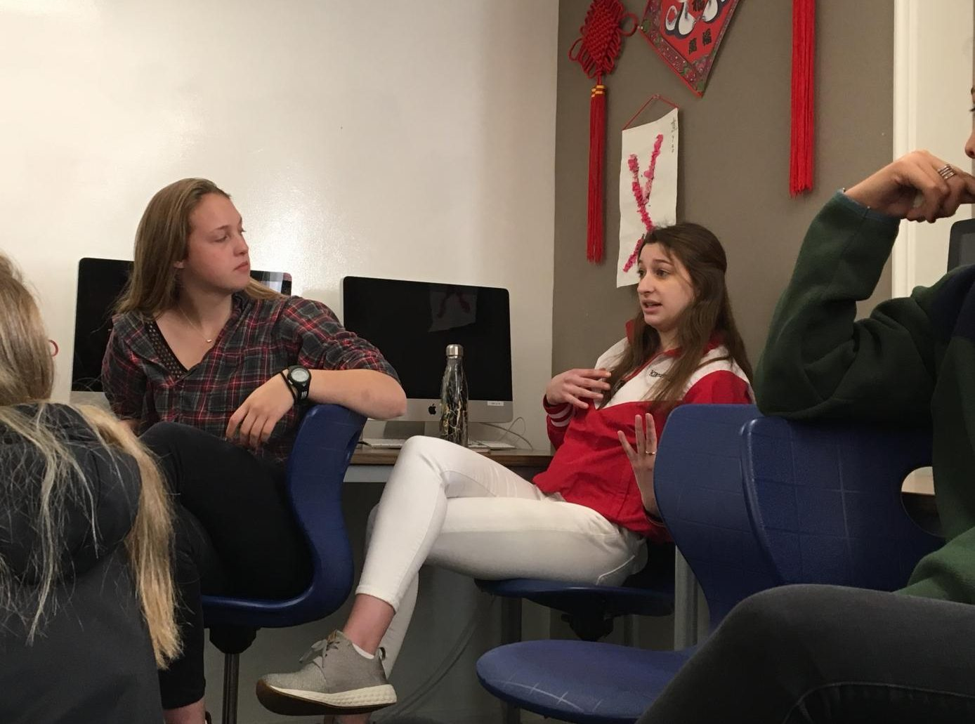 Junior Kiki Apple shares her opinion on the Second Amendment during her Theory of Knowledge class. The class postponed the lesson plan to discuss their perspectives on issues arising from recent school shootings.
