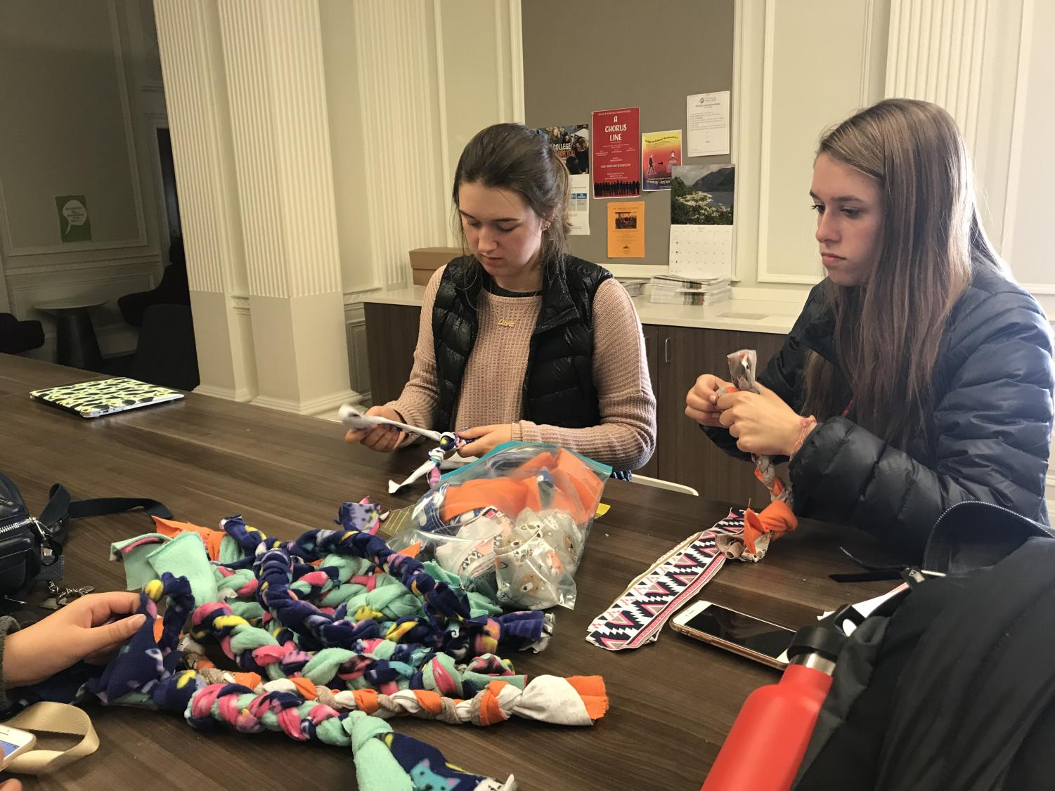 Sophomores Ella Beard and Peyton House create toys for cats and dogs by weaving pieces of fabrics tightly together. All 27 toys produced today will be donated to the Marin Humane Society shelter for pets.