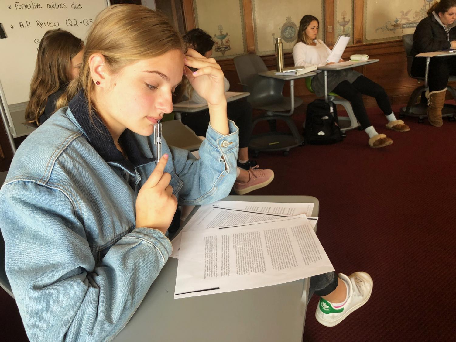 Junior Maggie Walter reviews an example passage from a past AP English Language and Composition exam. Walter will take the exam on Wednesday, May 16 with the rest of the IB and Honors English III Convent & Stuart Hall students.