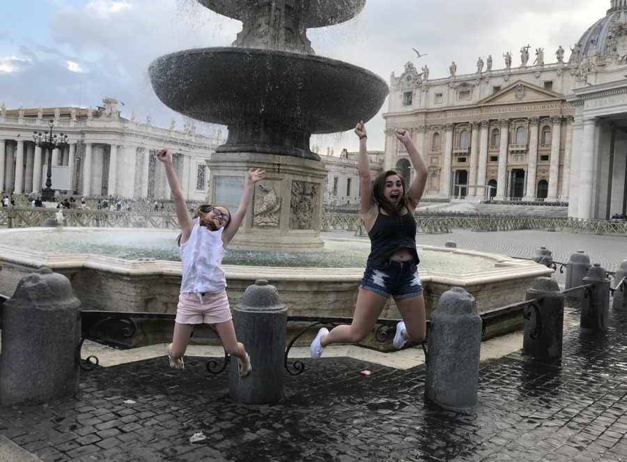 Senior+Megan+Mullins+jumps+with+her+sister+in+front+of+the+Fountains+of+St.+Peters+Square+in+Italy+in+June.+Students+shared+their+summer+experiences%2C+ranging+from+vacation+to+summer+school.+