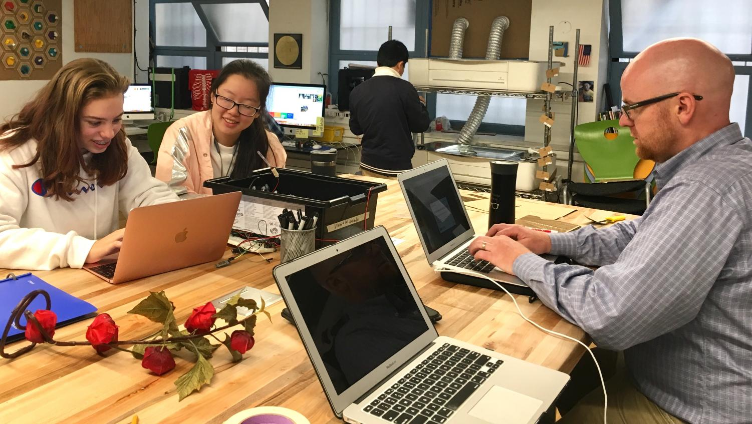 Club head Zoe Hinks and junior Michelle Wang discuss plans for the Innobotics Club with the club moderator during a lunch meeting in the Unkefer Spark Studio. The Clubs Assembly will be held on Monday.