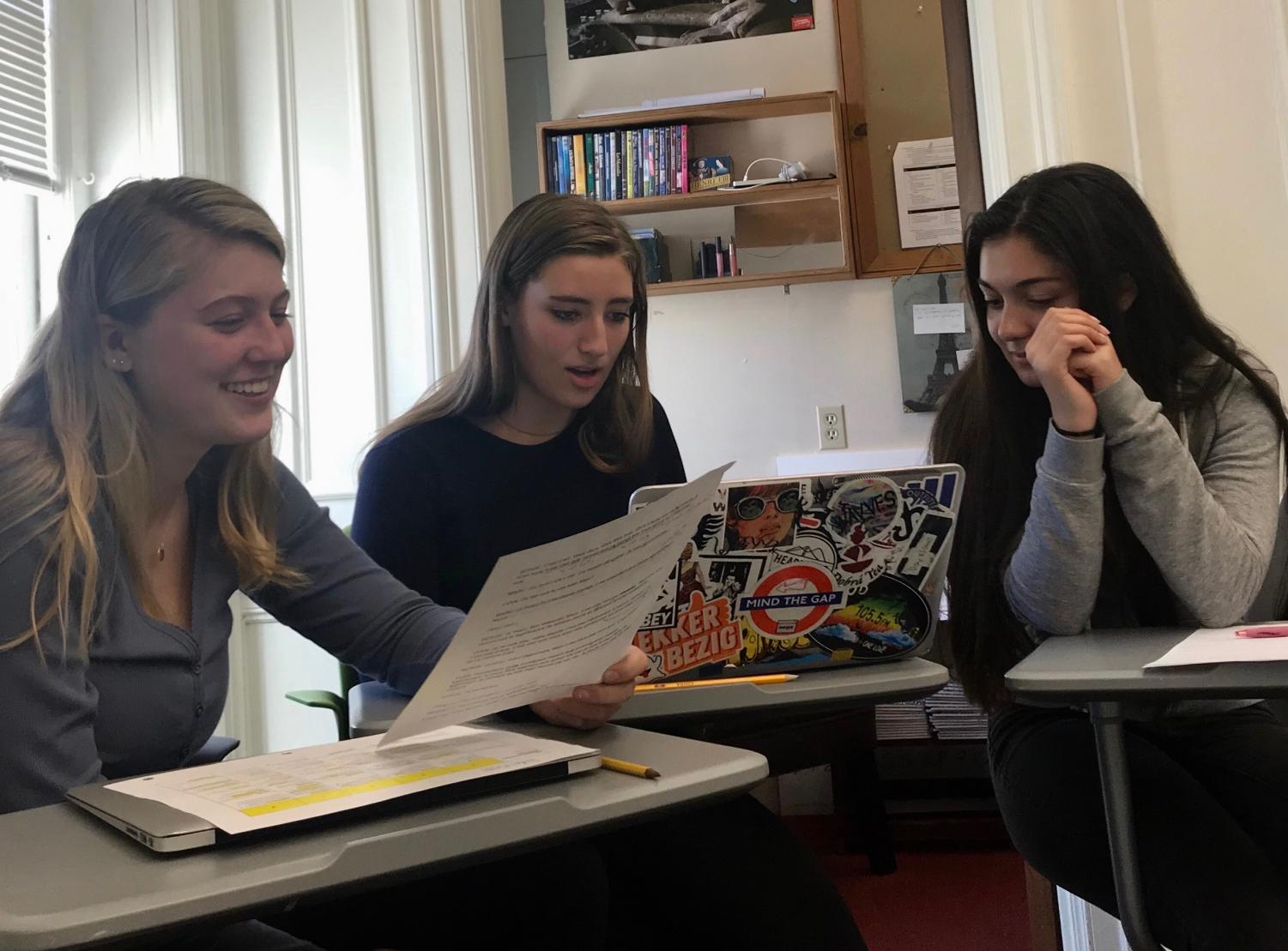 Seniors Jordan Russell, Caroline Phillips, and Laura Bourne read through their script. Students received edits on their work.