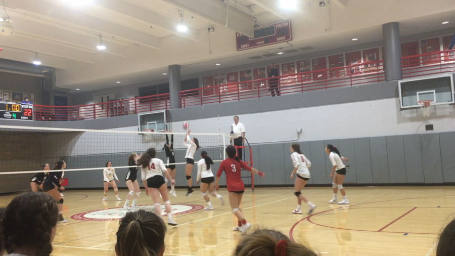 Junior+Bella+Shea+sets+the+ball+over+the+net+as+part+of+the+winning+point+in+the+game+against+Lick-Wilmerding+High+School.+The+varsity+volleyball+team+won+25-22+in+the+4th+set.