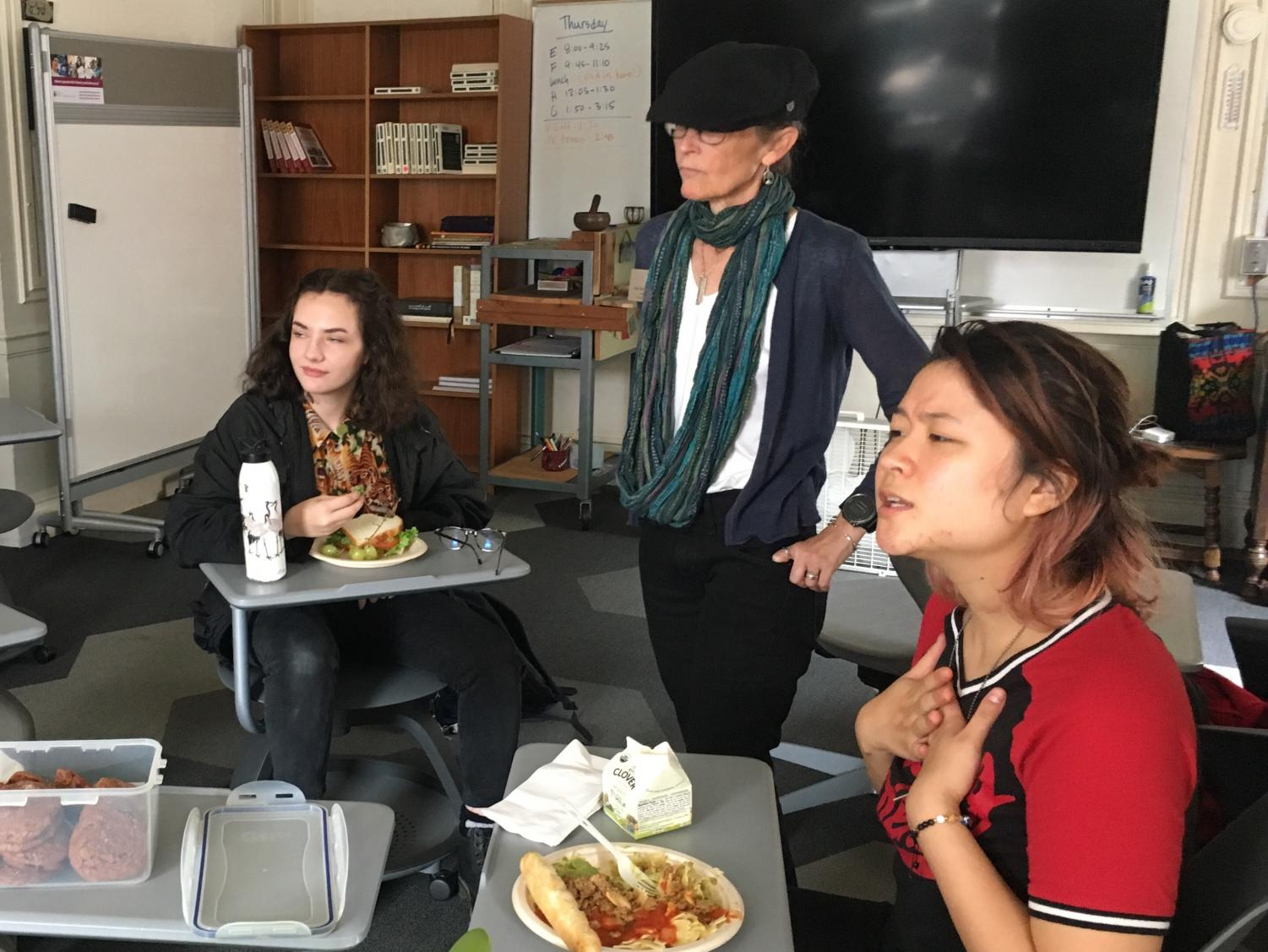 Club head Darrean Loy leads a discussion on LGBT+ representation in media during a Gender and Sexuality Awareness Club meeting. Club members enjoyed homemade Nutella cookies during the discussion.
