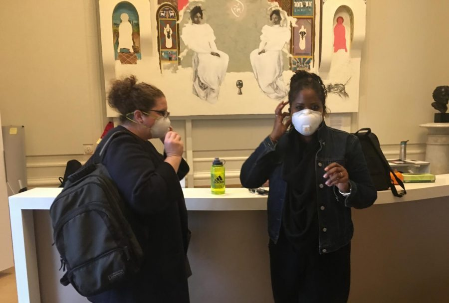 Grade+chair+Allyson+Maebert+puts+on+a+mask+in+the+Main+Hall+before+going+outside+of+the+Flood+Mansion.+Many+students+and+faculty+chose+to+wear+masks+to+prevent+inhaling+smoke+particles.