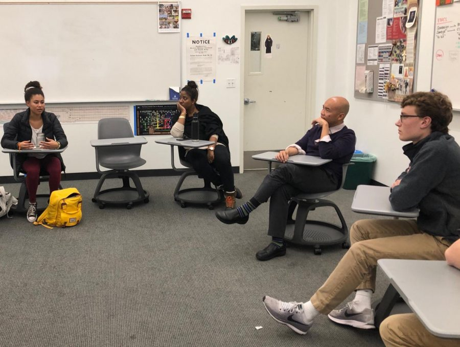 Junior+Maxi+Tellini%2C+Ethics+Teacher+Michael+Campos+and+People+of+Color+Student+Union+advisor+Allyson+Maebert+listen+to+junior+Ryann+Minnis+during+a+Collab+meeting.+Students+had+previously+expressed+interest+in+making+a+safe+coed+space+to+discuss++race+and+ethnicity.