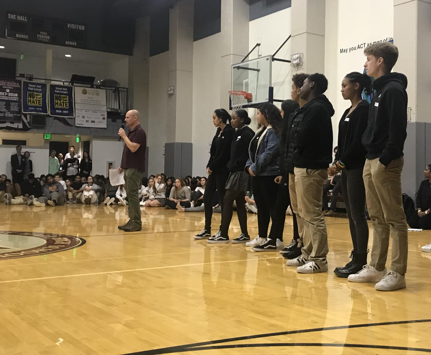 Members of POCSU line up in the Stuart Hall gym to present personal stories. Guest speaker Ted Saltveit mediated the conversation and asked students questions about their experiences with race.