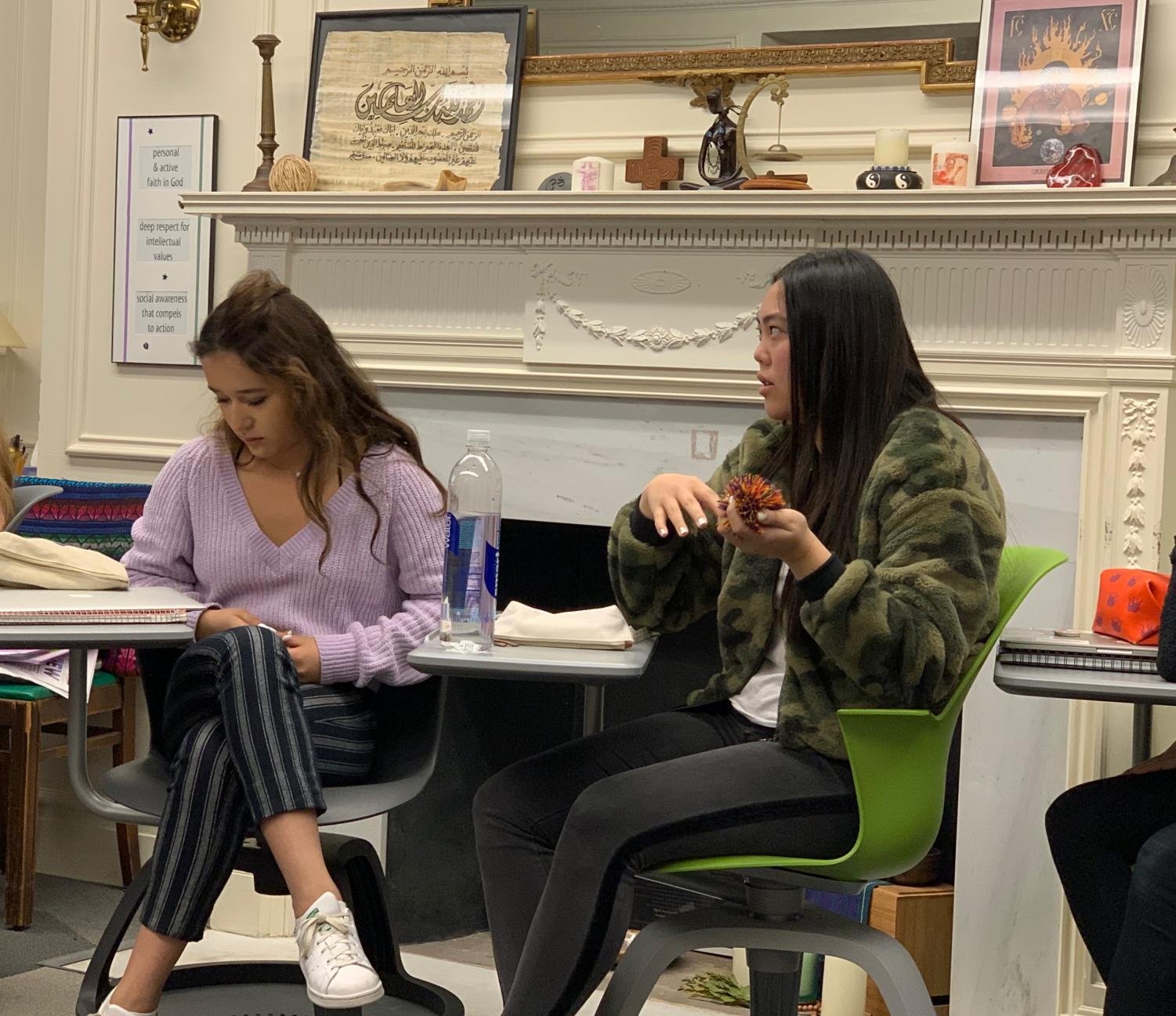 Freshmen Jennifer Surjadi reflects on what she found most interesting about Confucianism and Taoism in class today. The period often ends with reflection in order for students to show off what they learned during the class.