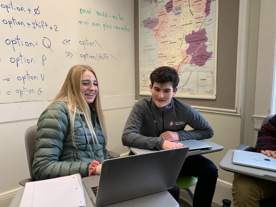 French+exchange+student+Jules+His+helps+freshman+Maddie+Drda+on+her+French+assignment.+His+is+visiting+Convent+%26+Stuart+Hall+for+the+next+two+weeks.