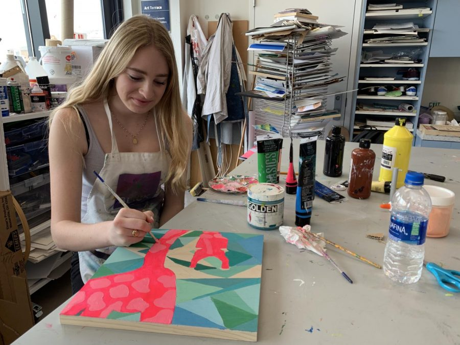 Freshman+Madeline+Drda+paints+a+giraffe+for+her+spirit+animal+art+project.+The+class+used+the+project+as+a+way+to+practice+color+theory.+
