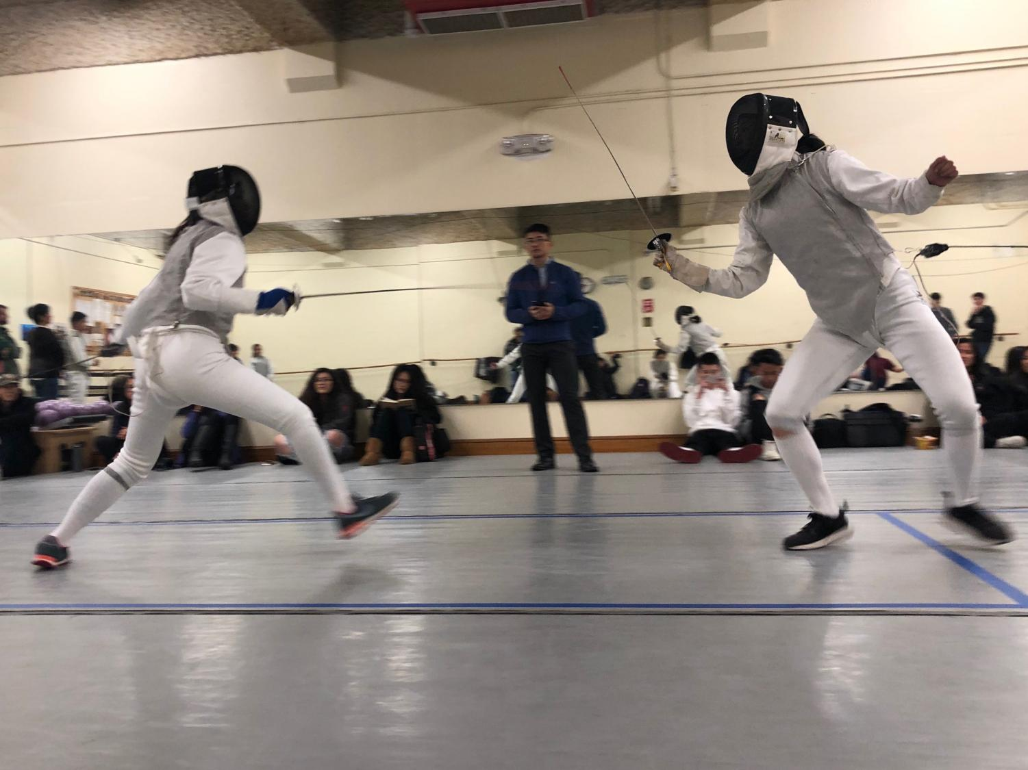 Senior Kelly Chan lunges for the opportunity to hit her opponent in a match against Lowell High School. Convent's fencing season has a win record of 1-2.