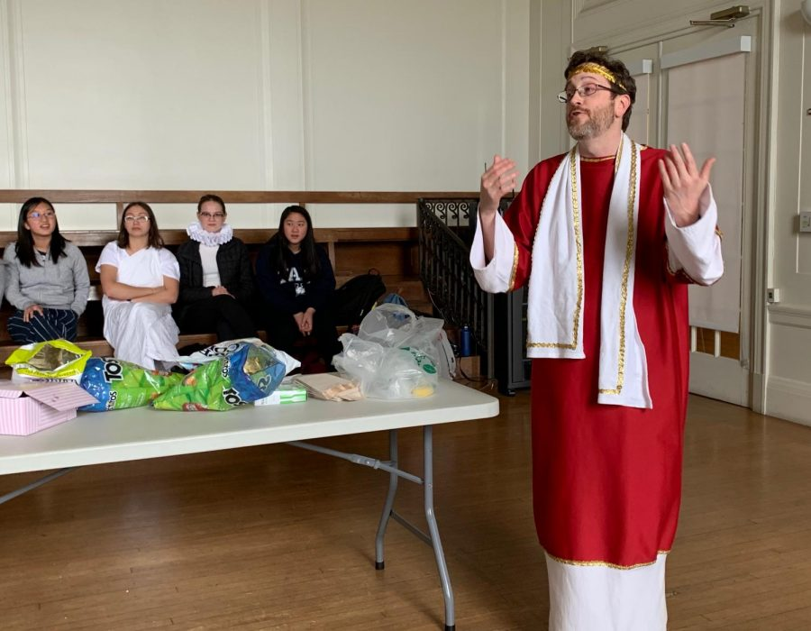 English+teacher+Mark+Botti+congratulates+the+winners+of+the+Shakespearian+references+contest+competition.+Botti+dressed+up+as+a+Roman+Senator+from+the+play+Julius+Caesar.+