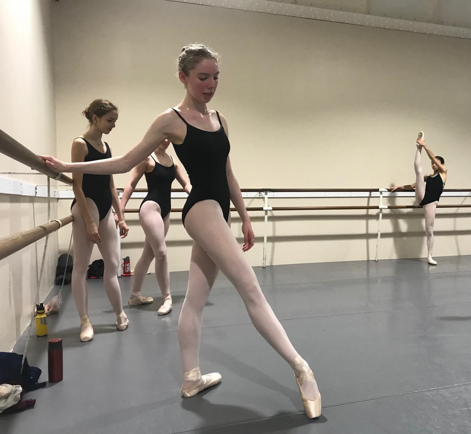 EN POINTE Junior Ari Levine practices her warm up combinations during a class with the Pre-Professional level of City Ballet. Levine has been dancing since she was three years old.