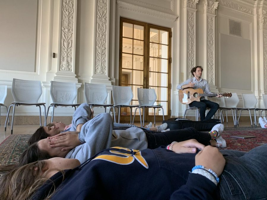 Bryan+Lorentz+sings+%22Here+Comes+the+Sun%22+during+a+guided+meditation.+Lorentz+ends+class+with+music+weekly.+