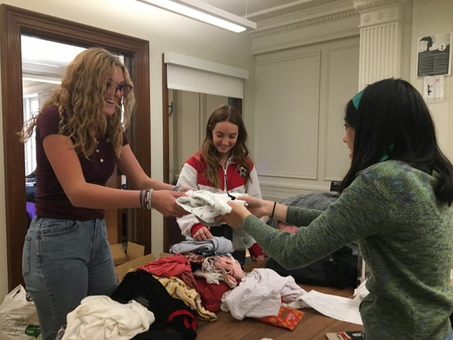 Sophomore+Anneli+Dolan+donates+a+shirt+to+the+Eco+Friends+clothing+swap.+%0AThrifting+and+purchasing+second-hand+helps+to+reduce+plastic+in+landfills+and+carbon+dioxide+emissions.%0A