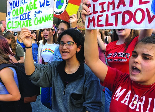 Juniors Jacqueline Guevara and Sofia Jorgenson hold up protest signs and chant during the San Francisco Youth Global Climate Strike on Oct. 3, 2019. Approximately 31 Convent & Stuart Hall students joined the school strike to march.