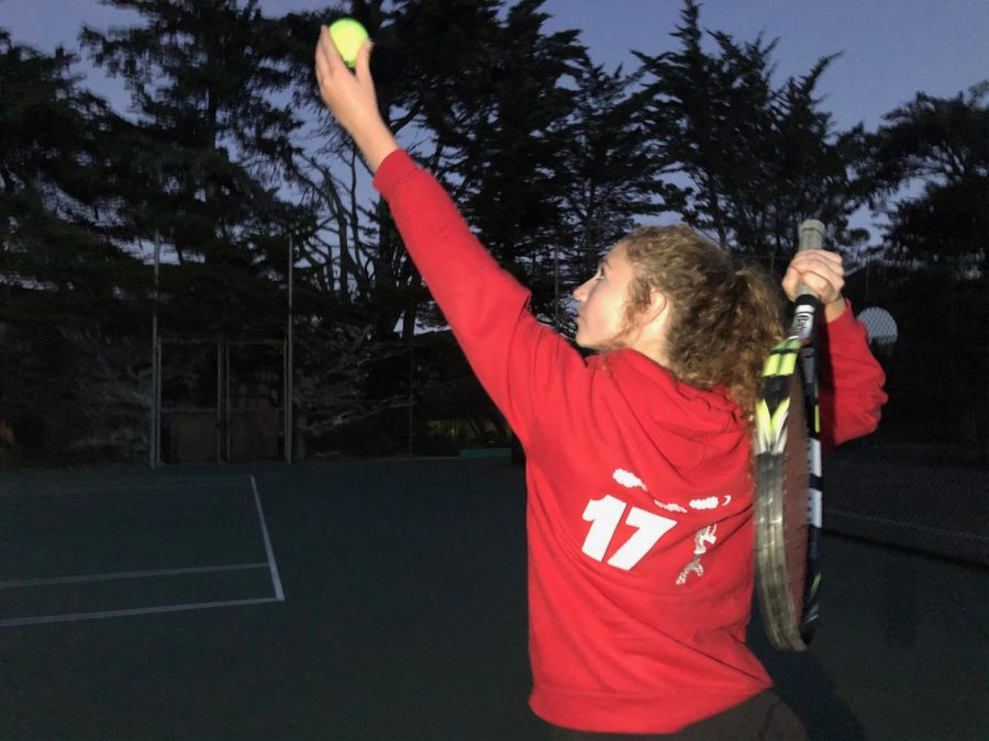 Junior+Ella+Holliday+serves+the+ball+during+a+practice+round.+Playoffs+will+continue+into+semi-finals+through+the+end+of+this+week+and+can+ultimately+extend+until+next+week+for+finals.++