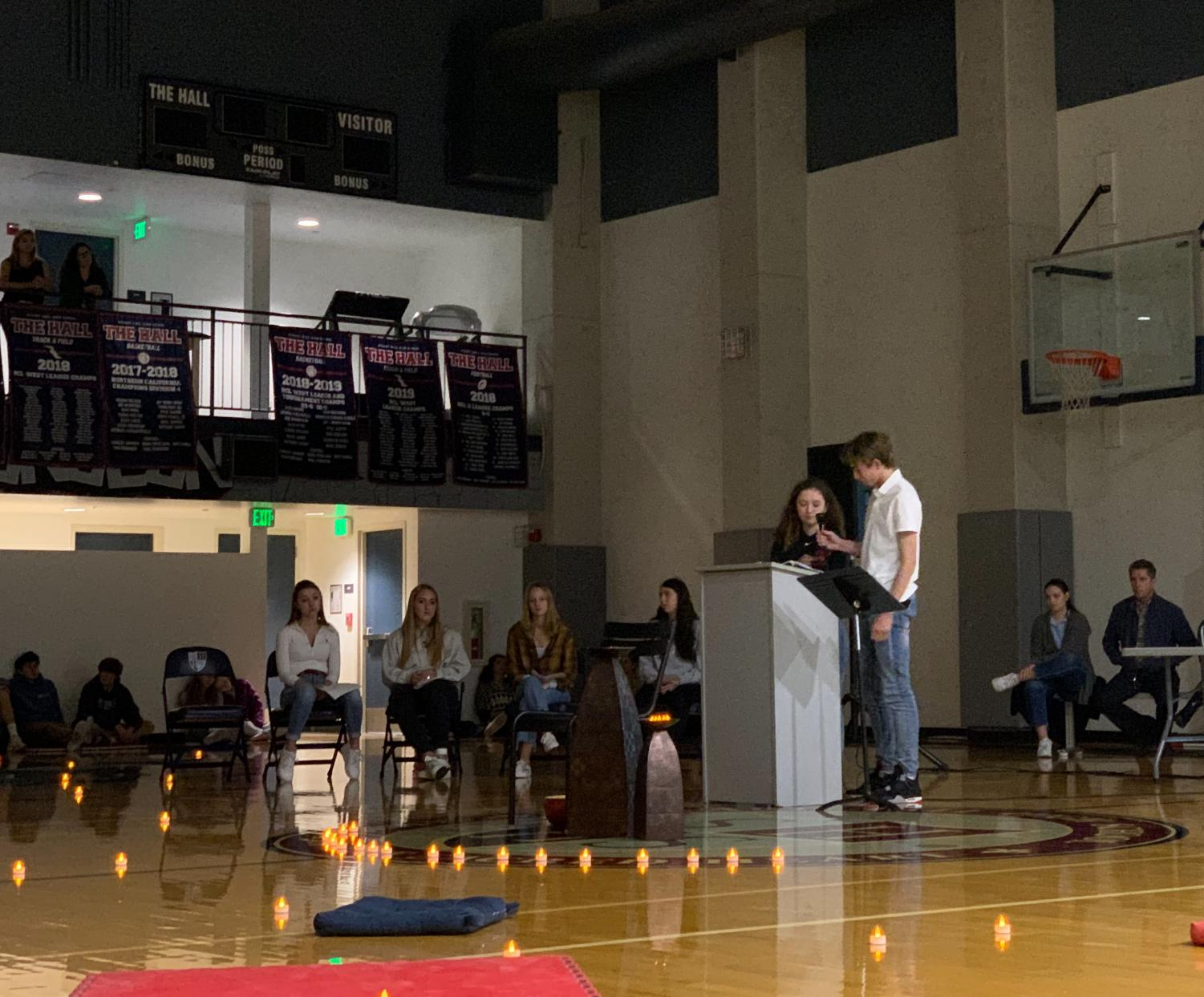 Sophomores Mackenna Moslander and Will Burns speak about their service at the all school chapel held in the gym. The focus was honoring the feast of Sacred Heart sister Philippine Duchesne.